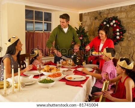 Hispanic family serving Christmas dinner - stock photo
