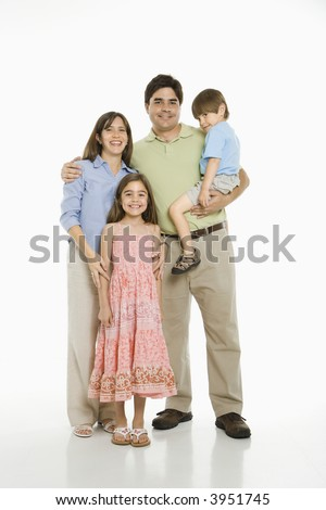 Hispanic family standing against white background. - stock photo