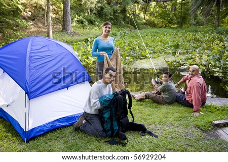 Hispanic family with two boys camping - stock photo