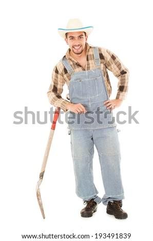 hispanic farmer holding a shovel on a white background - stock photo