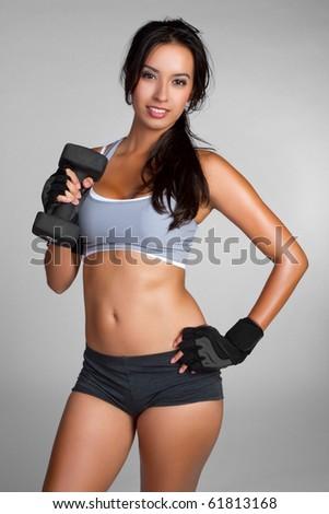 Hispanic fitness woman lifting weights - stock photo