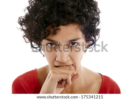 hispanic frustrated woman biting fingers, angry, looking at camera - stock photo