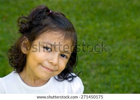 Hispanic girl at park. - stock photo