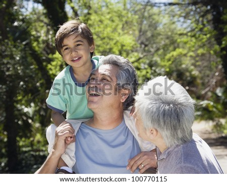 Hispanic grandparents with grandson outdoors
