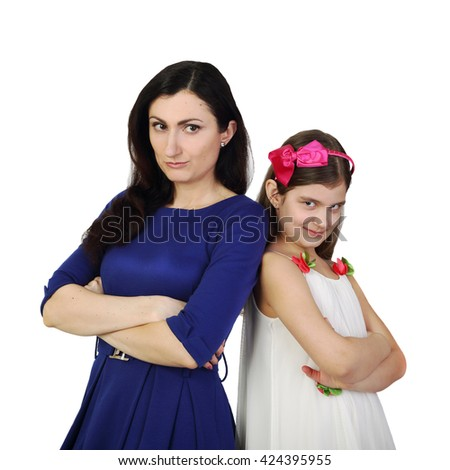Hispanic looking woman together with small girl isolated on white background in square - Mother and daughter are different but look the same - stock photo