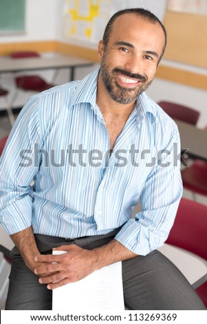 Hispanic Male Teacher in his classroom - stock photo