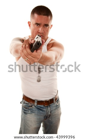Hispanic man pointing a handgun gangster style
