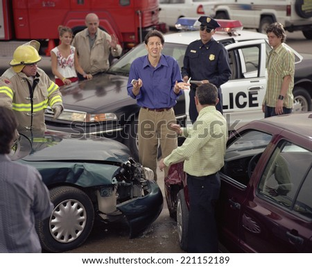 Hispanic man shrugging shoulders in middle of accident scene - stock photo