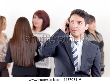 Hispanic man using a cellphone in the office - stock photo