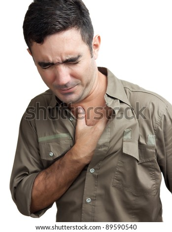 Hispanic man with a chest pain isolated on a white background - stock photo