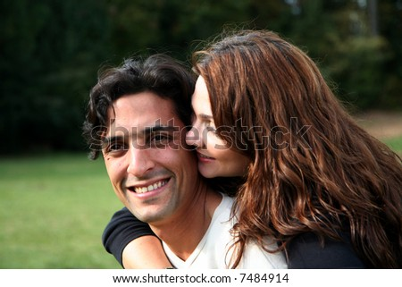 Hispanic married couple together outside in the fall - stock photo