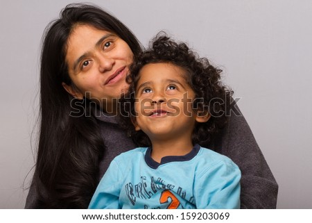 Hispanic Mom with Curly Hair Child