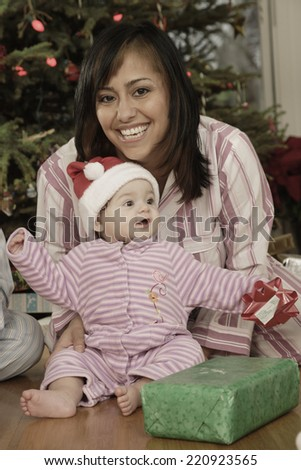 Hispanic mother and baby on Christmas - stock photo