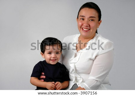 Hispanic mother and son smiling