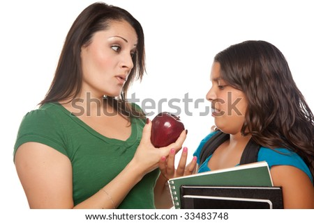 Hispanic Mother and Teen Aged Daughter with Books and Apple Ready for School Isolated on a White Background. - stock photo