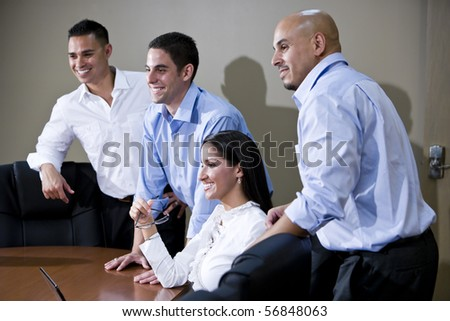 Hispanic office workers in boardroom watching presentation - stock photo