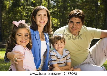 Hispanic outdoor family portrait. - stock photo