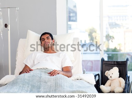 Hispanic patient resting in bed in hospital - stock photo