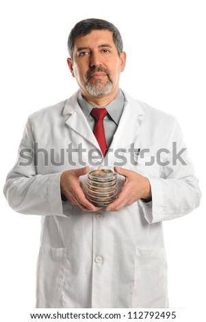 Hispanic scientist holding Petri dishes with bacteria isolated over white background
