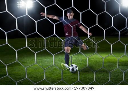 Hispanic Soccer Payer scoring during a game - stock photo