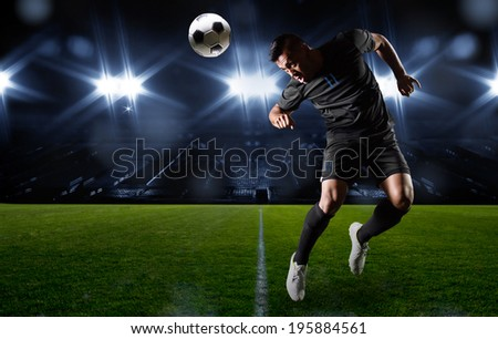 Hispanic Soccer Player heading the ball - stock photo