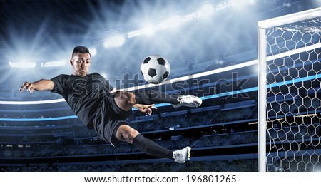 Hispanic Soccer Player kicking the ball - stock photo