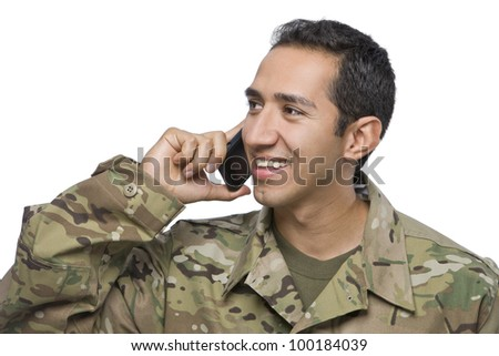Hispanic Soldier Uses a Cellphone
