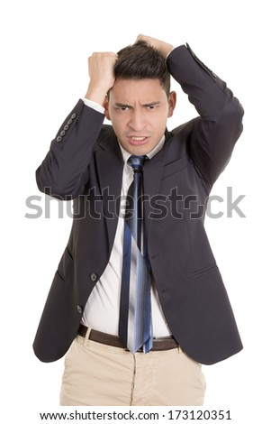 hispanic stressed businessman in suit - stock photo