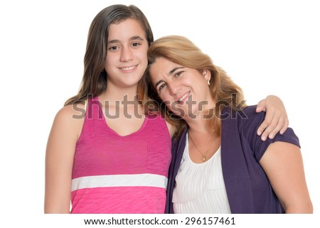 Hispanic teenage girl hugs her mother isolated on a white background