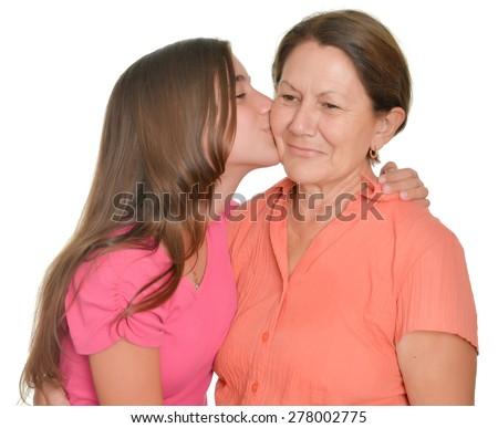 Hispanic teenage girl kissing her grandmother isolated on white - stock photo