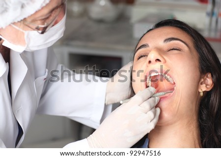Hispanic woman at the dentist - stock photo