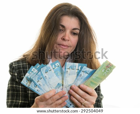 Hispanic woman counting Canadian dollars. Successful business woman in Canada's multicultural society. White background. Enjoying the fact of having money - stock photo
