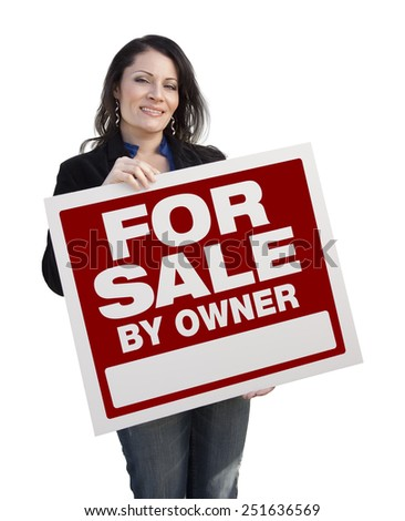 Hispanic Woman Holding For Sale By Owner Real Estate Sign Isolated On White. - stock photo