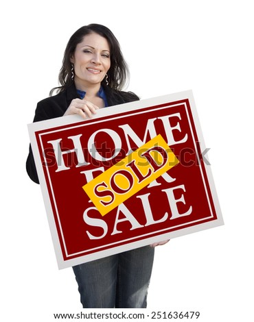 Hispanic Woman Holding Sold Home For Sale Real Estate Sign Isolated On White. - stock photo