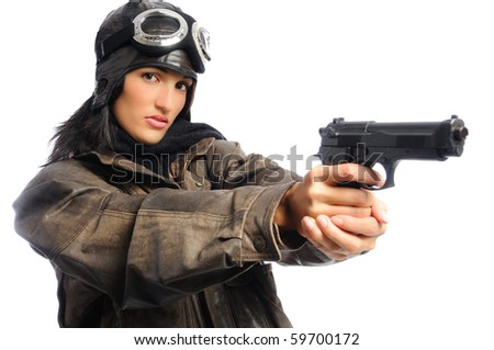 Hispanic woman in a vintage aviator costume holding a gun on a white background - stock photo