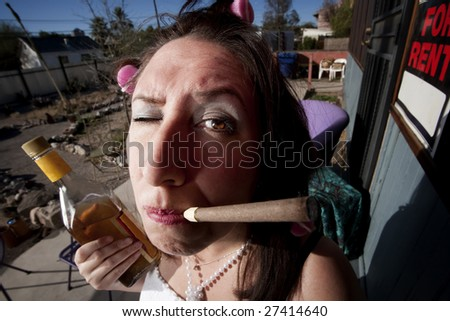 Hispanic woman in front of house with messy yard - stock photo