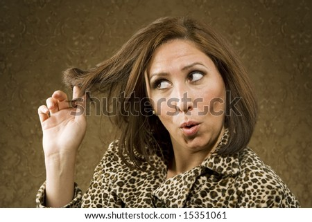 Hispanic Woman in Leopard Print Coat with Big Hair - stock photo
