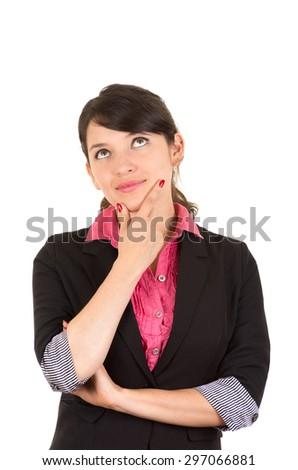 Hispanic woman in pink shirt and black blazer jacket facing camera with thoughtful facial expression looking upwards. - stock photo