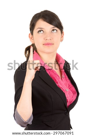 Hispanic woman in pink shirt and black blazer jacket holding one finger up looking upwards side angle. - stock photo