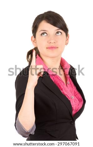 Hispanic woman in pink shirt and black blazer jacket holding one finger up looking upwards side angle. - stock photo
