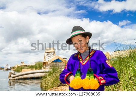 Hispanic woman in traditional indigenous clothing, Puno, Uros islands, Peru