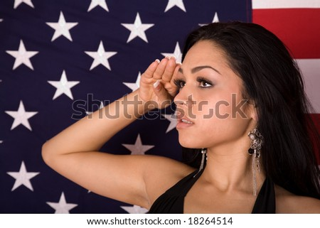 Hispanic Woman Saluting in front of an American Flag - stock photo