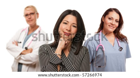 Hispanic Woman with Female Doctor and Nurse Isolated on a White Background. - stock photo