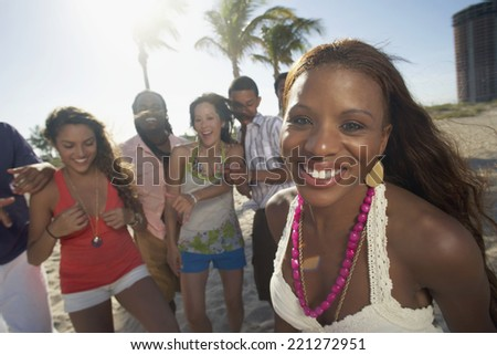 Hispanic woman with friends in background
