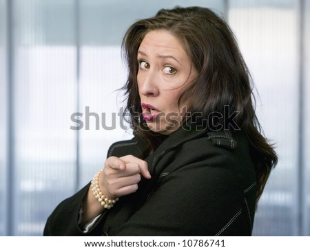 Hispanic Woman With Her Arms Crossed Pointing A Finger - stock photo