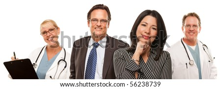 Hispanic Woman with Husband and Male Doctors or Nurses Isolated on a White Background. - stock photo