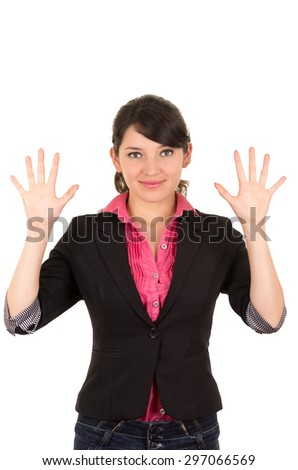 Hispanic woman with pink shirt, black blazer jacket facing camera holding both hands up and open in the air. - stock photo