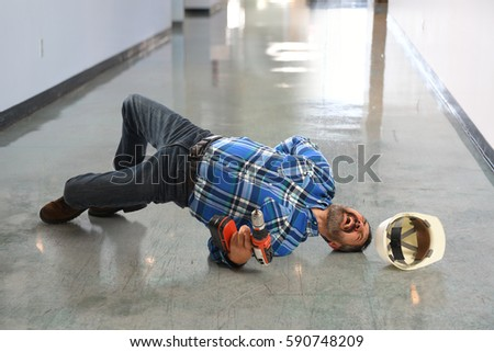 Hispanic worker falling on flor screaming in pain