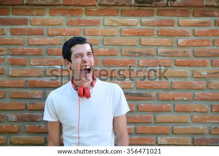 Hispanic young man screaming. Shouting expression. - stock photo