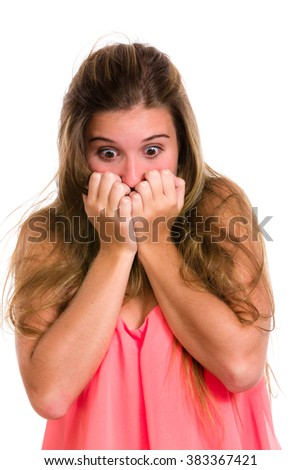 Hispanic young woman with fear expression and hands on face.  - stock photo